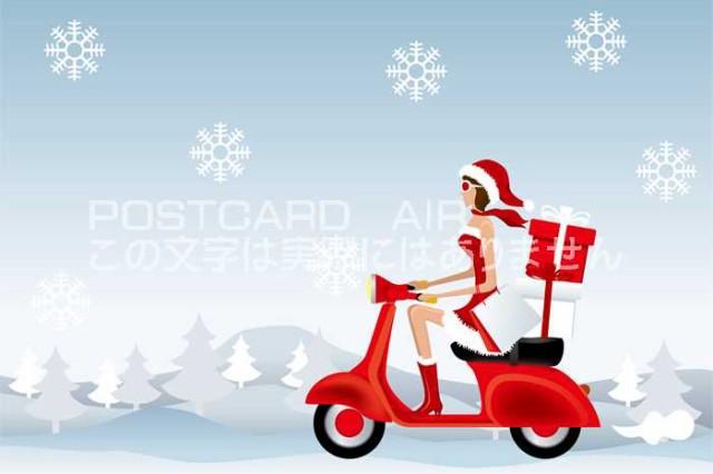【限定クリスマスのポストカード】サンタクロースの服を着た女性がバイクでゆくハガキはがき絵葉書