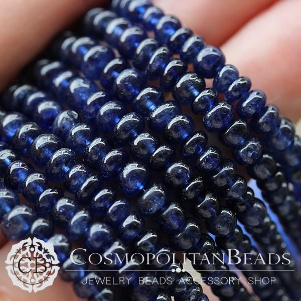 天然石グラスフィールドブルーサファイヤ(ボタンプレーン)大きさ 約2〜4×3.5〜5mm穴径 約0.4〜0.5mm35個 約10cm